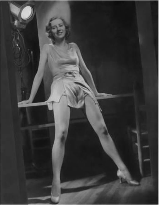 Horst P. Horst: Gertrude McDonald, 1931, actress, leaning back on table with studio light behind, for the Broadway play 'The Third Little Show'.